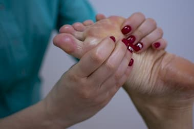 foot massage with oil is being provided to a person in a massage centre in Islamabad