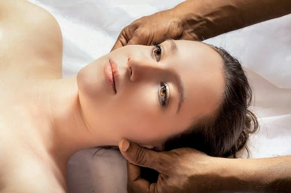female getting massage in a massage centre